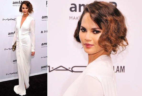 Chrissy Teigen Smolders in White