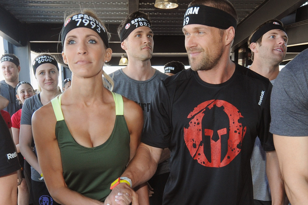 Celebrity trainers Chris & Heidi Powell take on the Reebok Spartan Race at Citi Field on April 12, 2014 in New York City.