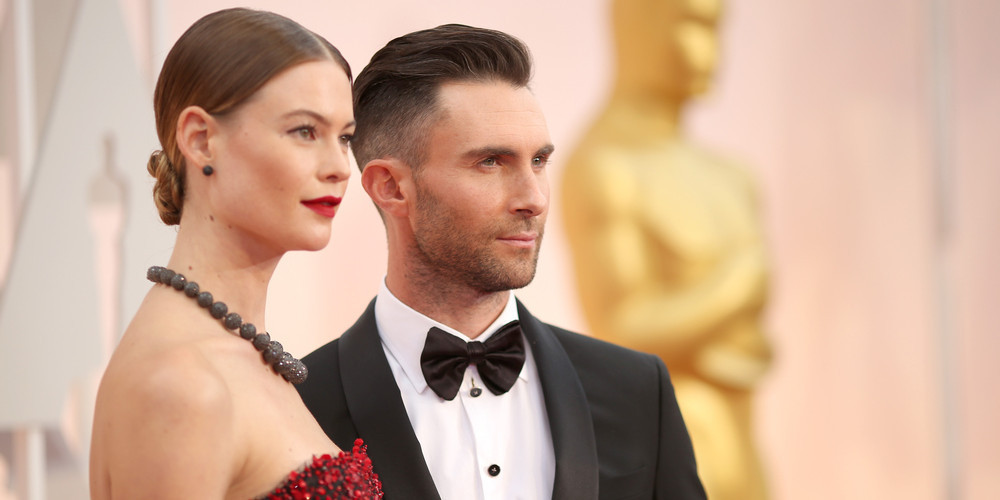 Behati Prinsloo and Adam Levine attended the 87th Annual Academy Awards on February 22, 2015 in Hollywood, California.