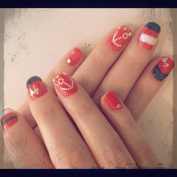Zooey Deschanel is Still Making Nail Art Look Good