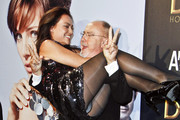 """Bigas Luna lifts Actress Giovanna Zacarias  at the premiere of """"DiDi Hollywood"""" at the Capital cinema in Madrid."""