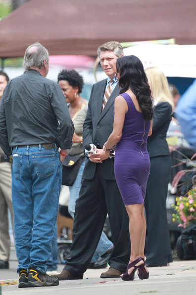 "Courteney Cox Actress Courtney Cox cools down with Smart Water in between filming scenes for ""Scream 4"" in Detroit. The actress is seen in a form fitting zipped up purple dress and platform heels."