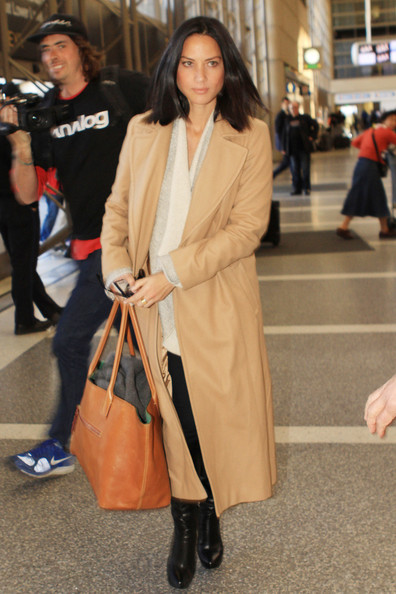 Actress Olivia Munn bundles up as she departs LAX airport in Los Angeles.