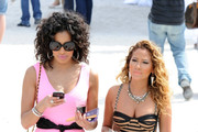 "Adrienne Bailon and Julissa Bermudez film for ""Empire Girls"" at the Maserati Polo World Cup in Miami where the girls dresses up to pose next to their favorite fast cars."