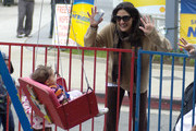 Alicia Coppola, film and television actress, and husband Anthony Michael Jones, hang out with their two daughters Mila and Esme while at a Los Angeles Farmer's Market. Alicia could be seen taking picutres of daughter Esme while riding a swing.