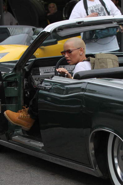 Amber Rose Amber Rose checks out cars whilst filming scenes for a reality show pilot. The model, who used to date rapper Kanye West, visited Platinum Motor Sports in West LA to look at cars, including a black lamborghini. .