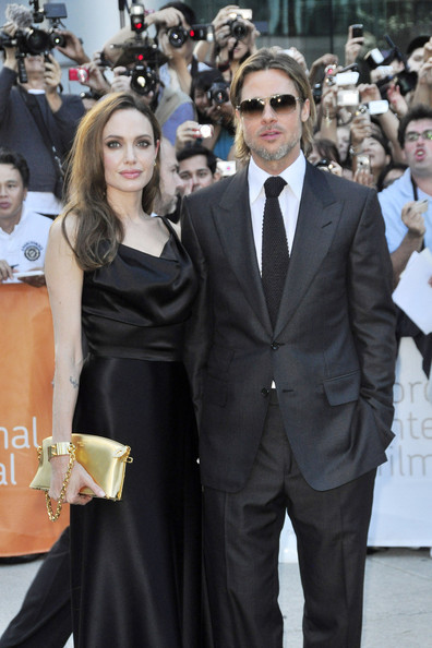 "Angelina Jolie - Superstar couple Brad Pitt and Angelina Jolie attend the premier of the new movie ""Money Ball"" at the Toronto Film Festival"