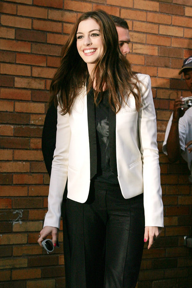 "Anne Hathaway ""One Day"" star Anne Hathaway is seen leaving the ""Daily Show With Jon Stewart"" in New York.  The beautiful actress poses for photographers outside the studios."