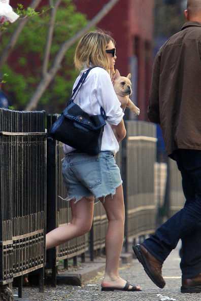 Ashley Olsen leaves her New York City home while holding onto her dog. Ashley, who was wearing cut off jean shorts and sandals, clutched her little pup close as she made her way to a waiting car.