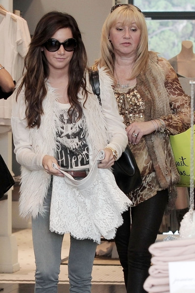"Ashley Tisdale Ashley Tisdale, wearing a faux fur gilet, holds up a lacy piece of lingerie while shopping with her mom Lisa in Beverly Hills. The ""Hellcats"" actress tweeted earlier today, ""I'm OBSESSED with faux fur right now! Just thought I'd say that. Off to a meeting..."" The slim actress was spotted out in Hollywood last night with her boyfriend, Scott Speer."