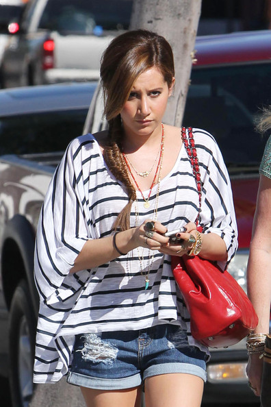 "Ashley Tisdale ""Hellcats"" star Ashley Tisdale walks to Urth Cafe accompanied by her mother Lisa. The actress, with her hair braided and sporting denim hotpants, recently tweeted to let her fans know that the show ""Miss Advised"" from her production company, Blondie Girl Products, was picked up by Bravo TV."