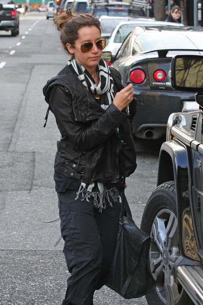 "Ashley Tisdale Ashley Tisdale, star of the CW's ""Hellcats,"" heads to the gym wearing baggy pants while in Vancouver. The petite actress walked briskly - with her hair in a messy bun and carrying an oversized Balenciaga tote bag."