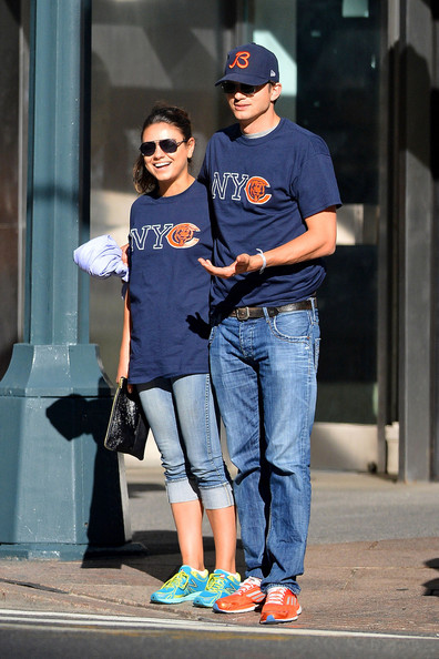Mila Kunis and Ashton Kutcher wear matching outfits as they get close during a walk in the West Village, NYC