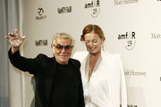 Roberto Cavalli and Eva Cavalli attend the third annual amfAR Milano event, held in conjunction with Milan Fashion Week at La Permanente in Milan. AmfAR, is The Foundation for AIDS Research and is one of the worldÕs leading nonprofit organisations dedicated to the support of AIDS research.