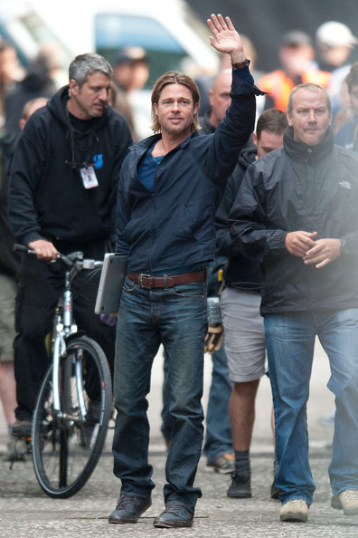 "Brad Pitt waves to screaming fans as he gets down to work in Glasgow, Scotland, shooting new scenes for the zombie epic ""World War Z"". The Scottish city is doubling as Philadephia for the drama."