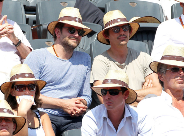 """Bradley Cooper and Lukas Haas take in a game during the French Open at the Stade Roland Garros. Coopers new film """"The Hangover: Part II"""" has broken box office records in the last couple of weeks."""