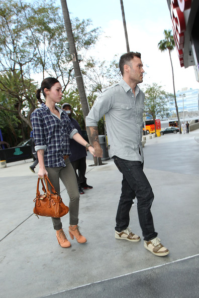 Brian Austin Green and wife Megan Fox spend their Sunday at the Lakers vs Denver Nuggets basketball game, held at the Staples Center in Los Angeles. The couple arrived and left the Staples Center walking hand in hand.