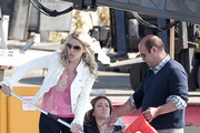 """Busy Philipps uses a pole to retrieve floating items in Marina Del Rey during a scene for """"Cougar Town"""". The cast was spotted celebrating as the boat was successfully launched off the dock, only later to see it sink underwater."""