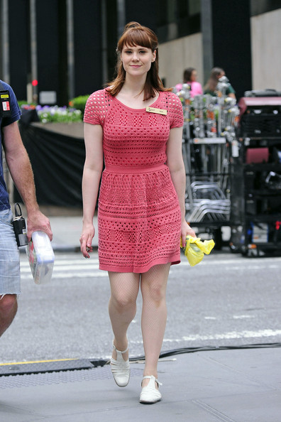 """British musician Kate Nash wears a pink dress and stockings as she walks to the set of """"Syrup"""" in New York."""
