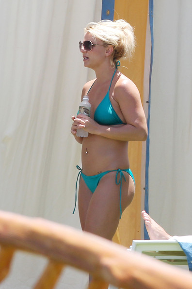 Britney Spears Britney Spears and her beau Jason Trawick spend a sunny morning in Hawaii relaxing by the pool of their luxury hotel. The couple have been vacationing on the tropical island since Tuesday and look as though they are having a great time. Britney was wearing a blue bikini and a short, brown summer dress, while Jason could be seen showing off his washboard abs.