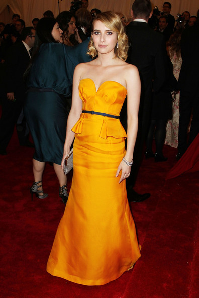 Emma Roberts walks the red carpet at the Met Gala at the Metropolitan Museum of Art in NYC.