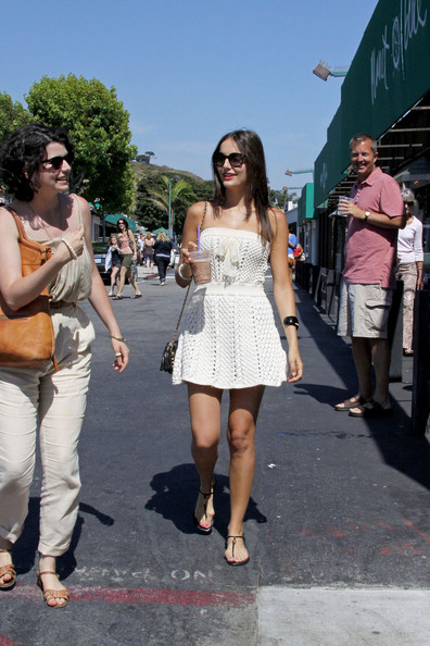 Camilla Belle enjoys an iced coffee as she goes shopping with a friend at Planet Blue in Malibu.