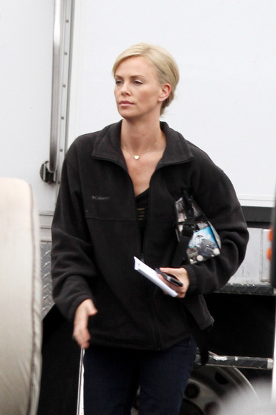 "Charlize Theron leaves her trailer on the set of ""Young Adult"" holding onto her makeup bag, with Eclipse gum inside. The 35-year-old South African actress stayed warm in a thick black coat and ugg boots. Theron's character is Mavis Gary, a divorced writer who returns to her hometown to find that a former lover she wanted to reconnect with is married with a family."