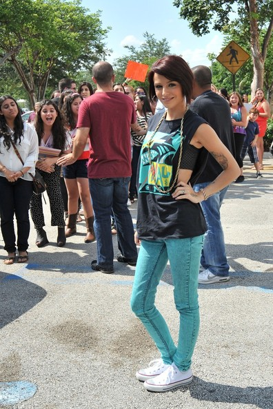 "Cher Lloyd, fourth runner-up in the seventh series of the British version of ""The X Factor"", shows off her new short hair cut whilst making an appearance at Y100 radio station in Miami. Lloyd, sporting skinny acid wash jeans and an 80's style tank top, hung out with a large group of her young fans while promoting her new single 'Want You Back' as part of her US radio tour. Despite the 95 degree heat, Cher greeted and reportedly took a photo with every one of her fans, most who had stood outside for several hours. One young female fan even got down on one knee and proposed, although Cher is already set to walk down the aisle with her fiance Craig Monk who's waiting patiently for her back in England."