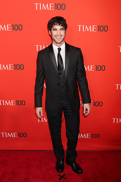 Darren Criss Darren Criss poses for photographs while attending the Time 100 Gala, held at the Time Warner Center in New York City.