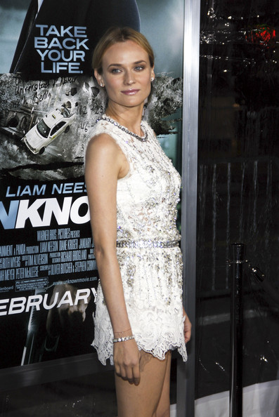 "Diane Kruger Diane Kruger at the Los Angeles premiere of ""Unknown"" held at the Regency Village Theatre, Los Angeles. She was wearing a white lace Dolce & Gabbana Spring 2011 dress. Her embellished mini dress is simply styled with a pulled back hairstyle, glossy lips and nude Brian Atwood pumps.."