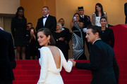 Jeremy Renner and Marion Cotillard arrive for 'The Immigrant' screening during The 66th Annual Cannes Film Festival at the Palais des Festivals.