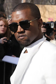 Kanye West always keeps his style on point. He attended the Chanel fashion show in Paris sporting unique shades.