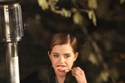 Emma Watson continues filming the latest ad for Lancome with director Mario Testino in Paris. The 'Harry Potter' star is seen wrapped in a towel in between takes with her male co-star.