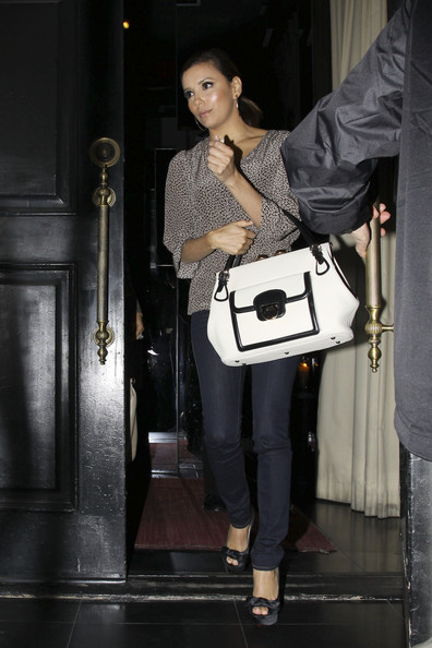 Eva Longoria Eva Longoria leaves 'Beso' after a business meeting. The actress was showcasing a fabulous new handbag as she left her restaurant in Los Angeles.