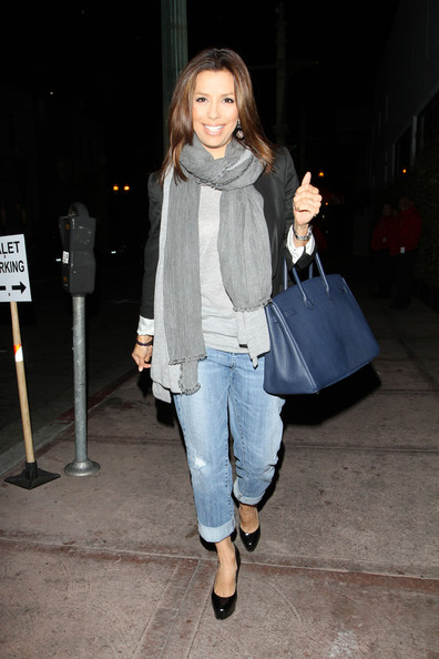 Eva Longoria carries her blue Birkin bag as she walks up to her Hollywood restaurant, Beso, for some dinner.