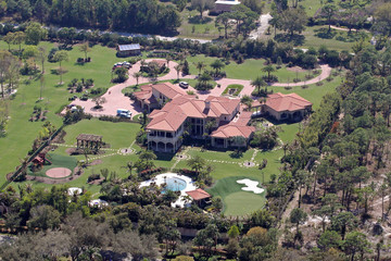 Tiger Woods Flo Rida FILE PHOTO: JUST A DRIVE AWAY - Tiger Woods Builds New Home For Mum Just Miles From His New Mansion At A Total Cost Of $100 Million - Seen Here Tiger Woods' Home