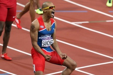 Flag Felix Sanchez of Dominican Republic theatrically wins the gold medal in the 400m hurdles at the Summer Olympic Games 2012 in London.
