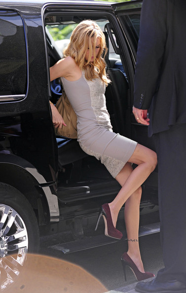 """""""Gossip Girl"""" star Katie Cassidy shows off her ankle tattoo as she arrives at the Ritz-Carlton hotel in New York for new movie """"Monte Carlo"""" press junket. Her tatto reads """"Love Thyself, Know Thyself"""". The romantic comedy was produced by Nicole Kidman and features a song by star Selena Gomez and her band """"The Scene""""."""