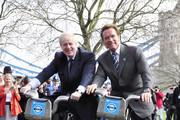 Governor of London Boris Johnson and former Governor of California Arnold Schwarzenegger cycle around outside of City Hall on London's bikes.