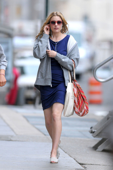 "Greta Gerwig, wearing a grey hoodie over a blue dress, is spotted on the New York City set of her upcoming comedy ""Lola Versus""."