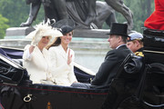 Kate, Duchess of Cambridge waves to spectators as she shares a carriage with Prince Harry and Camilla, the Duchess of Cornwall, for the Trooping the Colour.  William, the Duke of Cambridge, took part in the parade for the first time while his new wife, Kate watched.