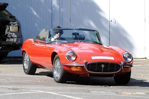 Harry Styles, from the boy band One Direction, spends his day test driving a vintage Jaguar E-Type Roadster in Hampstead, London. The 18-year-old singer reportedly took the vintage sports car for a test spin before trying out something a bit more modern, a Porsche 911.