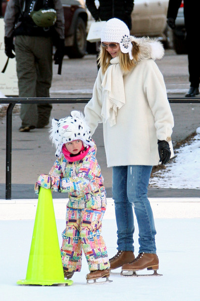 Heidi Klum holds onto her daughter Helene while doing a bit of ice skating in Aspen. Heidi and husband Seal take their kids ice skating while spending their holiday in Aspen. Heidi strapped on a pair of ice skates to accompany her kids Helene, Henry and Johan on the ice. The kids were wearing animal shaped helmets and one piece jump suits. Seal kept to his sneakers and camera, taking pictures of wife Heidi and his kids skating around the rink.