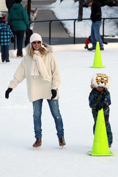 Heidi Klum sticks close to her son Henry while doing a bit of ice skating in Aspen. Heidi and husband Seal take their kids ice skating while spending their holiday in Aspen. Heidi strapped on a pair of ice skates to accompany her kids Helene, Henry and Johan on the ice. The kids were wearing animal shaped helmets and one piece jump suits. Seal kept to his sneakers and camera, taking pictures of wife Heidi and his kids skating around the rink.