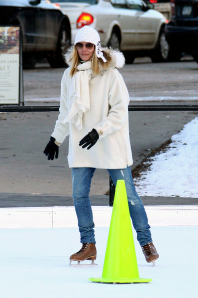 Heidi Klum and husband Seal take their kids ice skating while spending their holiday in Aspen. Heidi strapped on a pair of ice skates to accompany her kids Helene, Henry and Johan on the ice. The kids were wearing animal shaped helmets and one piece jump suits. Seal kept to his sneakers and camera, taking pictures of wife Heidi and his kids skating around the rink.