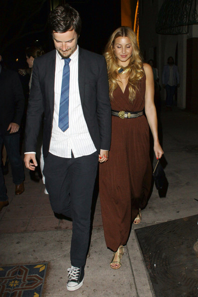 """The Hills"" star Whitney Port and a new mystery man attend the premiere of ""The Change Up"" at the village theatre in Westwood. The star, who split with boyfriend Ben Nemtin in June, wore a brown grecian style maxi dress to the premiere."