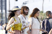 Hippy chick Isabel Lucas looks lovely in lace on the final day of the Coachella Music and Arts Festival 2011. The Aussie actress was spotted walking around the festival ground with her hirsuite beau Angus Stone.
