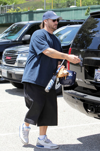 Kevin Federline heads for home after coaching his son Sean Preston in his little league baseball game.