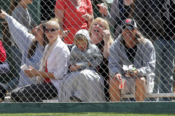 A pregnant Victoria Prince watches over Jayden while attending Sean Preston's little league baseball game.