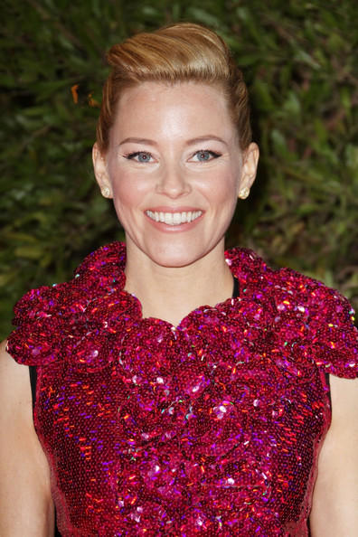 "Elizabeth Banks attends the ""Hunger Games"" movie premiere, viewed by 1,500 fans at the Gaumont Marignan Cinemas on the prestigious Avenue des Champs Elysees in Paris."